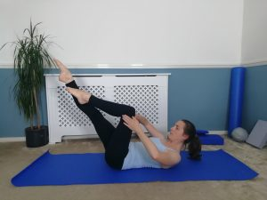Double Tabletop maintaining Abdo Prep Position. Pilates one leg stretch