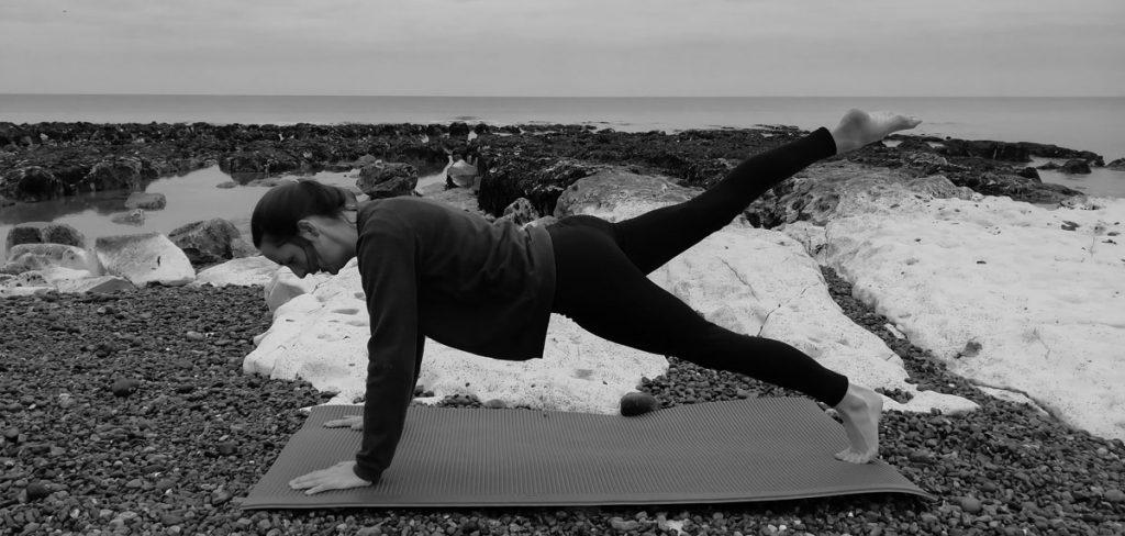 Leg pull in prone Pilates exercise